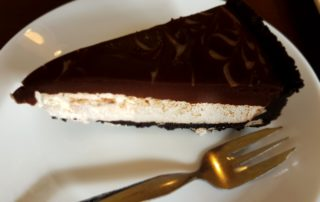 Oreo CheeseCake and a fork on position on a plate