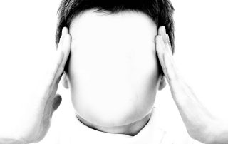 A person holding his head, because of too much stress. This is typical for many product managers