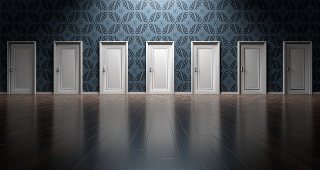 Eight doors which look the same in a room. This image represents the decisions a product manager must make each day.